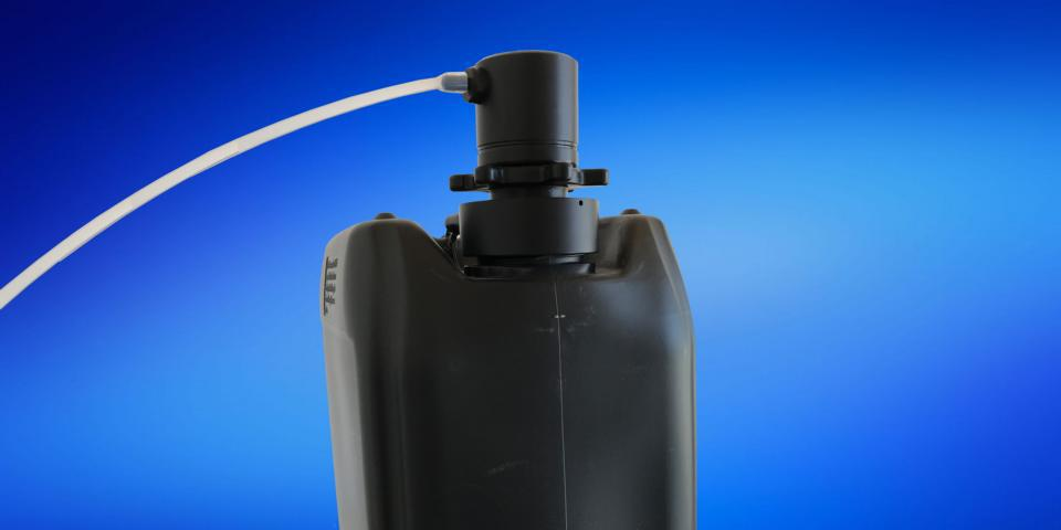 electrically conductive M2-Series Dispense Head connected to canister